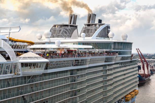 Cruise ship sail away, leaving Port Everglades, Florida for a Caribbean Cruise . Cruise ship sail away, leaving Port Everglades, Florida. Passengers waving good bye. stock photo
