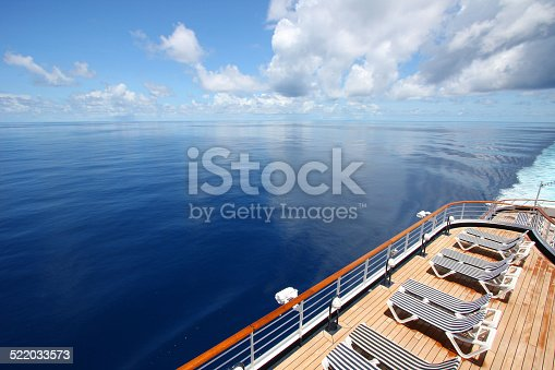 istock Cruise ship sails across a beautiful calm ocean. 522033573