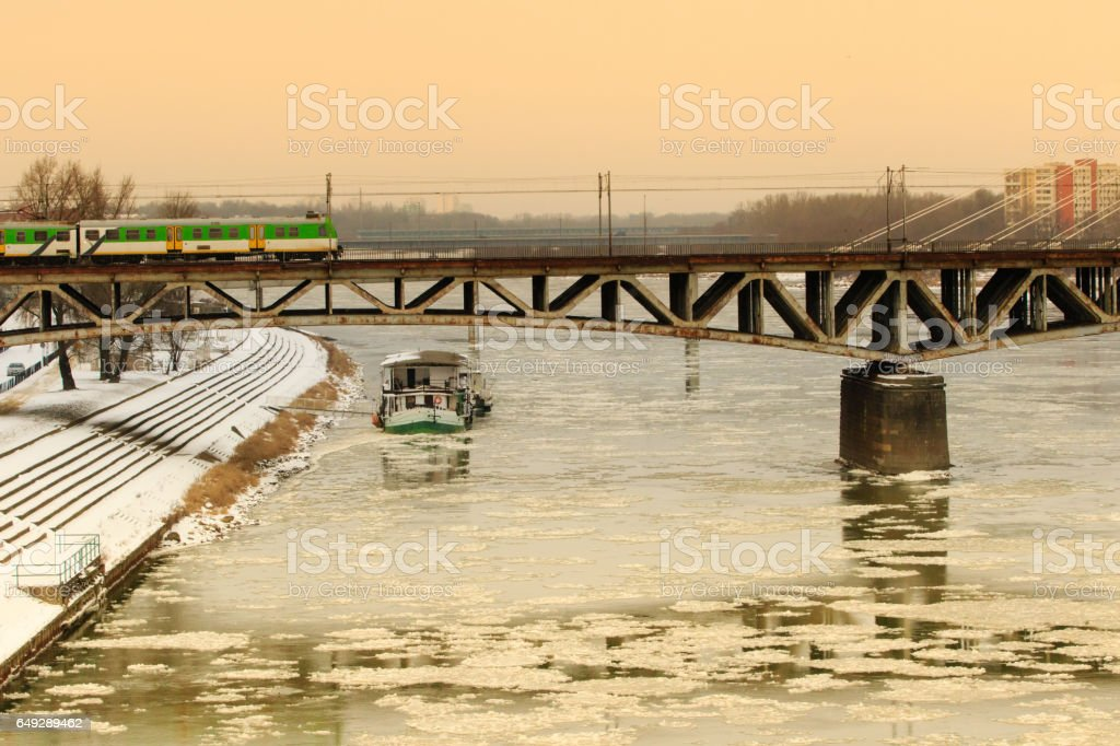 Cruise ship under the bridge with train across the river stock photo