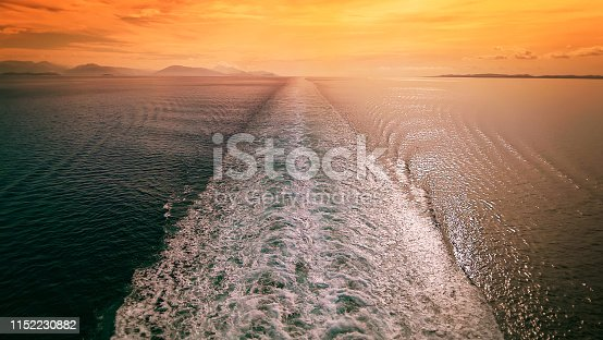 Cruise ship wake in the Mediterranean sea at sunset, travel vacation