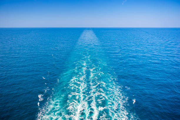 Cruise ship wake or trail on ocean surface, white trace