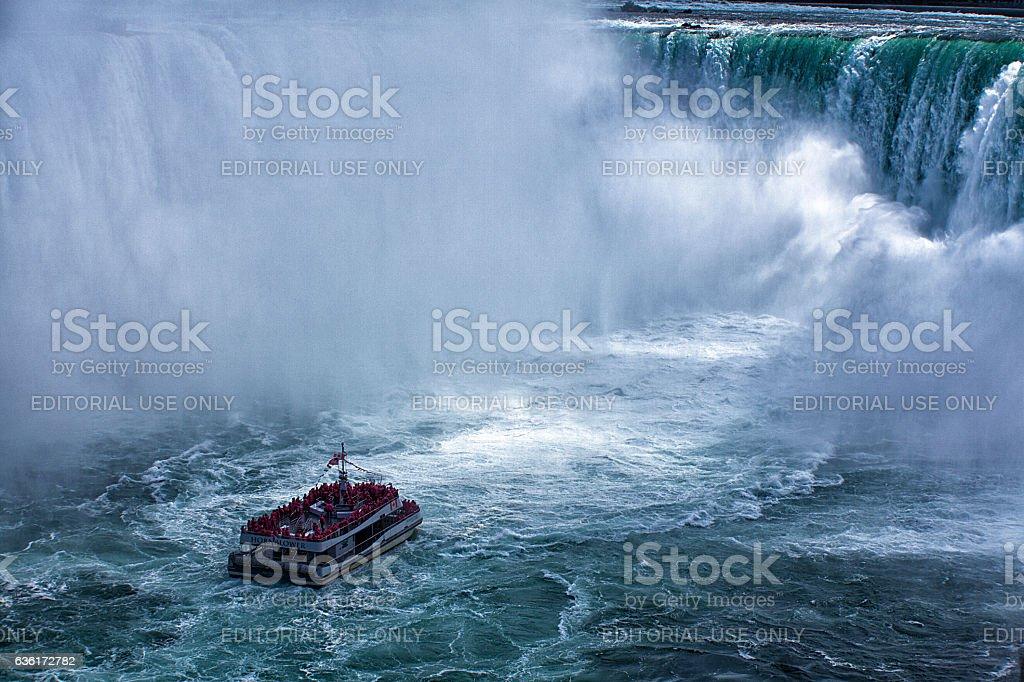 Cruise ship with lots of people approaching Niagara Falls stock photo