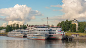 Uglich, Russia - July, 07, 2018. Cruise ship at the pier on the Volga river in the ancient  town of Uglich