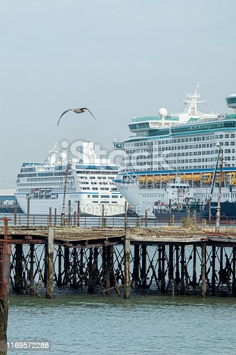 Cruise ships docked at Southampton sea port on the south coast of England with an old rickety jetty in the foreground. Plenty of space for copy to sit on.