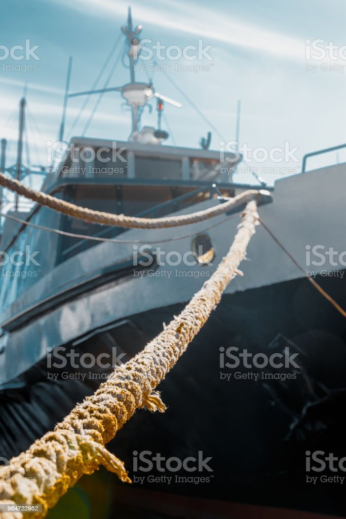 Cruise Travel Summer Concept. Marine Ship Moored To A Berth, Close-up Selective Focus Blur Image royalty-free stock photo