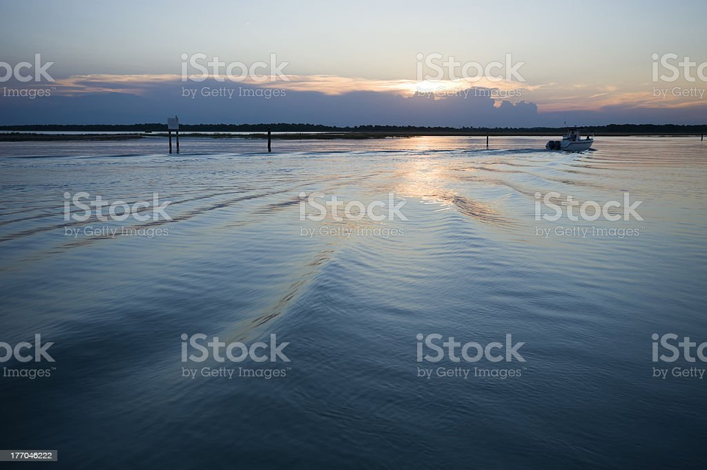 Cruising at sunset royalty-free stock photo