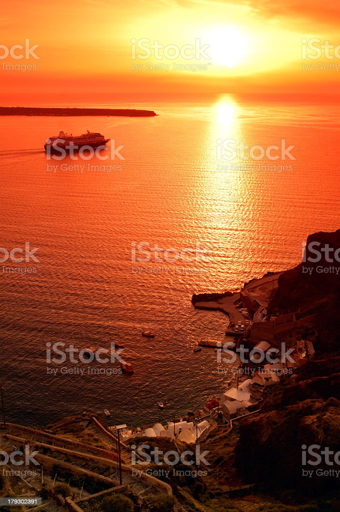 Cruising boat with magnificent sunset in the background royalty-free stock photo