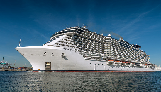 Miami, FL, USA - April 22, 2020: Cruise ships stopped at the port due to the global crisis of the Coronavirus epidemic (COVID-19) in the Port of Miami, one of the busiest ports in the United States.