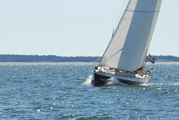 cruising - yacht front view stock photos and pictures