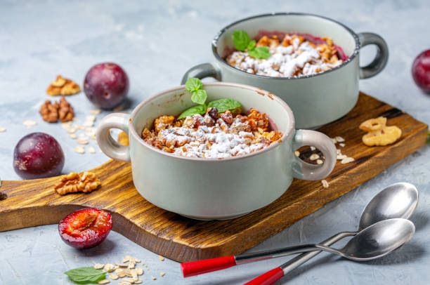 Crumble of red cherry plum, oatmeal and walnut. stock photo