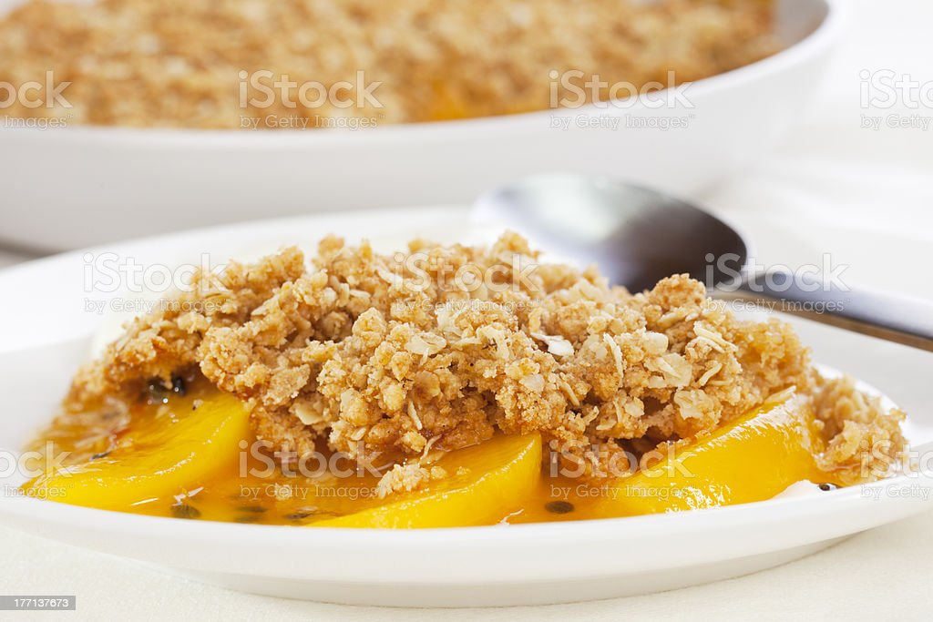 Crumble with Peach and Passion Fruit stock photo