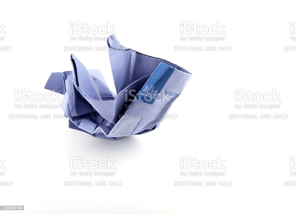 Crumbled envelope of the Dutch IRS stock photo