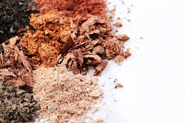 crumbled eyeshadows of different colors on a white background - minéraux photos et images de collection