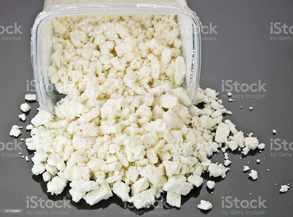 crumbled feta cheese stock photo