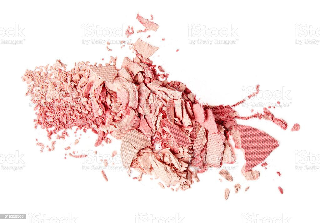 crumbled pink blush and powder on white background stock photo