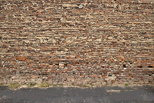 crumbling brick wall - green screen background stock photos and pictures