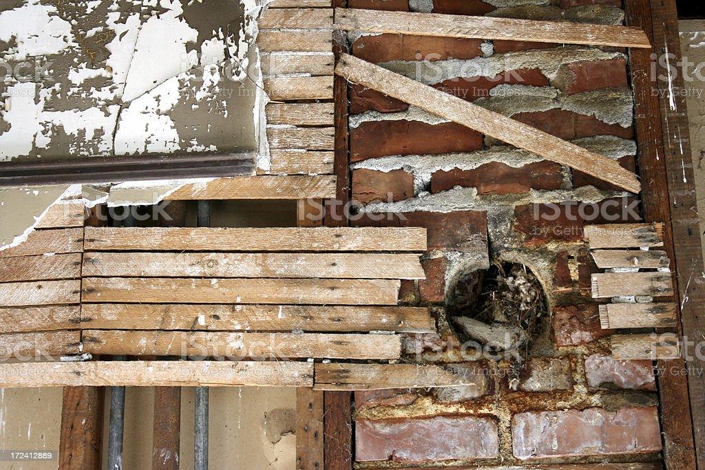Crumbling chimney bricks, broken wall slats royalty-free stock photo
