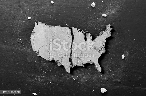 Crumbling Shape of America - Do to coronavirus quarantine the USA economy and housing market crumbling concept on black background.