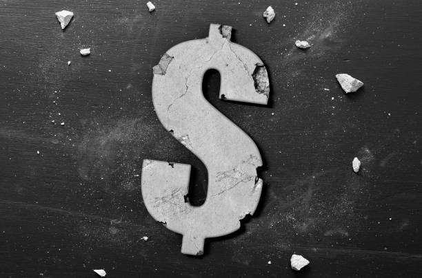 usa crumbling economy and housing market concept with dollar sign - mphillips007 stock pictures, royalty-free photos & images