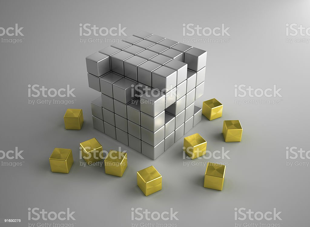 Crumbling gold and silver cubes royalty-free stock photo
