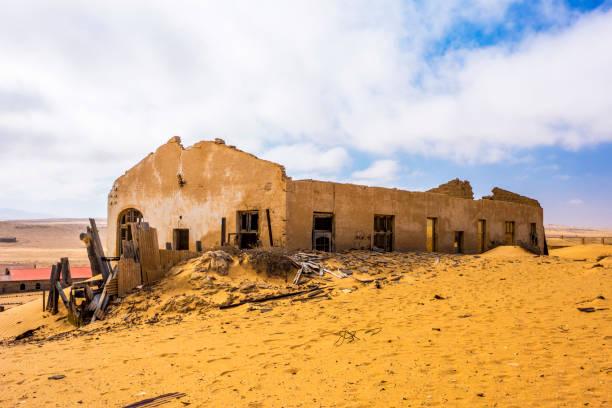 Crumbling Kolmanskop buildings stock photo