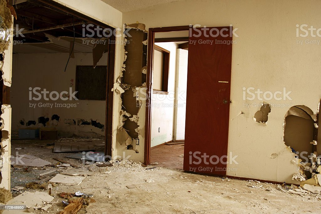 Crumbling sheetrock walls in Abandoned Home royalty-free stock photo