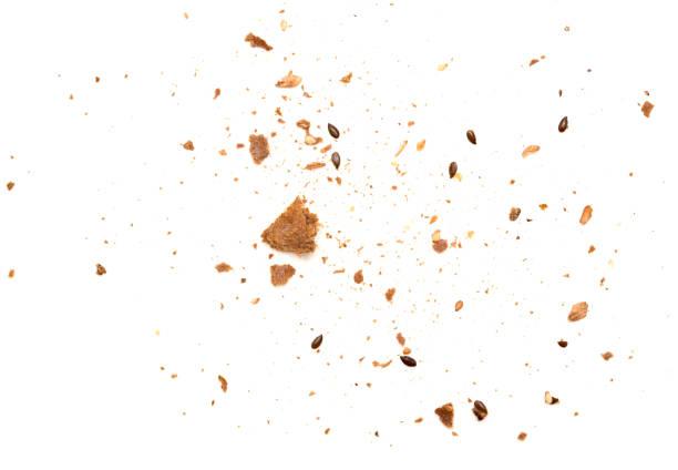 crumbs isolated - briciola foto e immagini stock