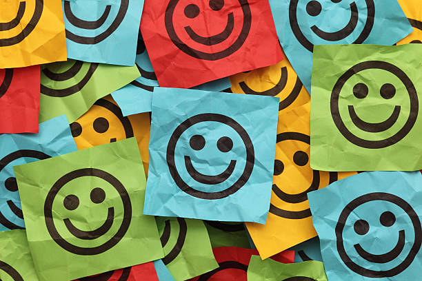 crumpled adhesive notes with smiling faces - emoticons stock photos and pictures