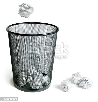 Crumpled balls of paper throwing into trash bin, on white background.