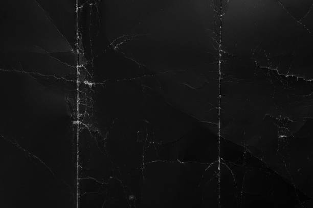Crumpled black cardboard with wrinkles and wrinkled folds. Old wrapping dusty paper Crumpled black cardboard with wrinkles and wrinkled folds. Old wrapping dusty paper. Abstract dramatic background. For design and titles. folded stock pictures, royalty-free photos & images