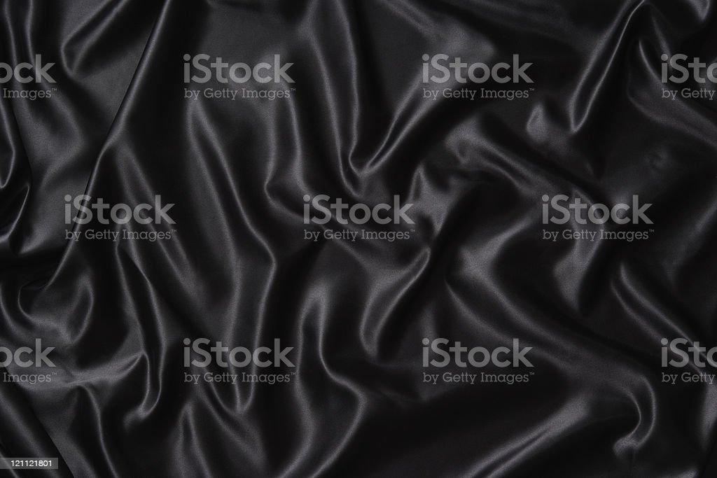 Crumpled black satin texture background stock photo