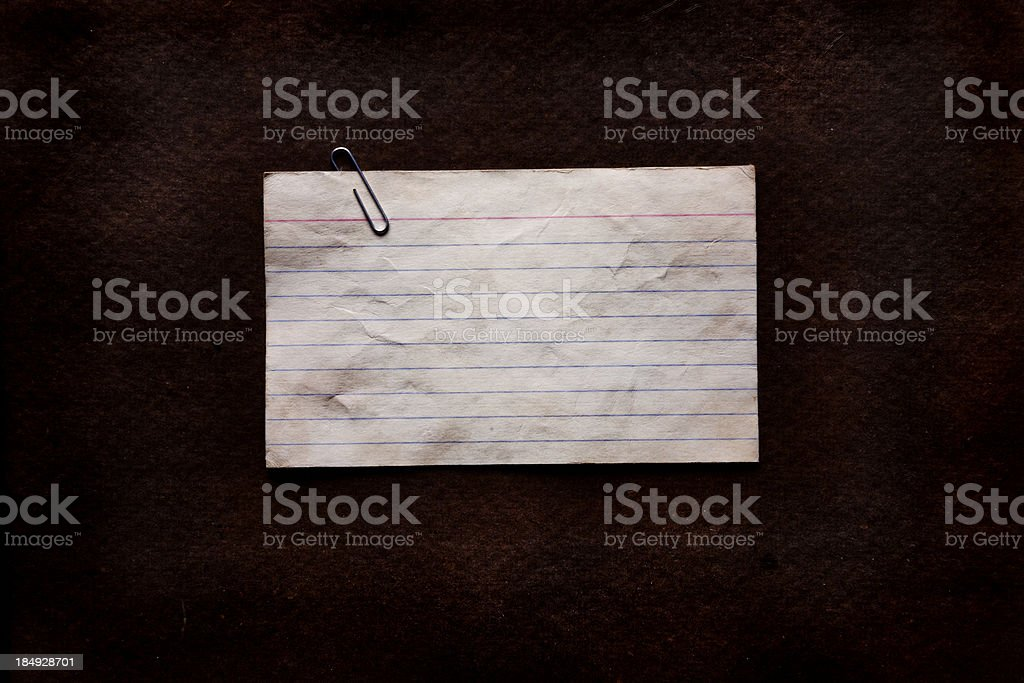 Crumpled blank note on textured background royalty-free stock photo