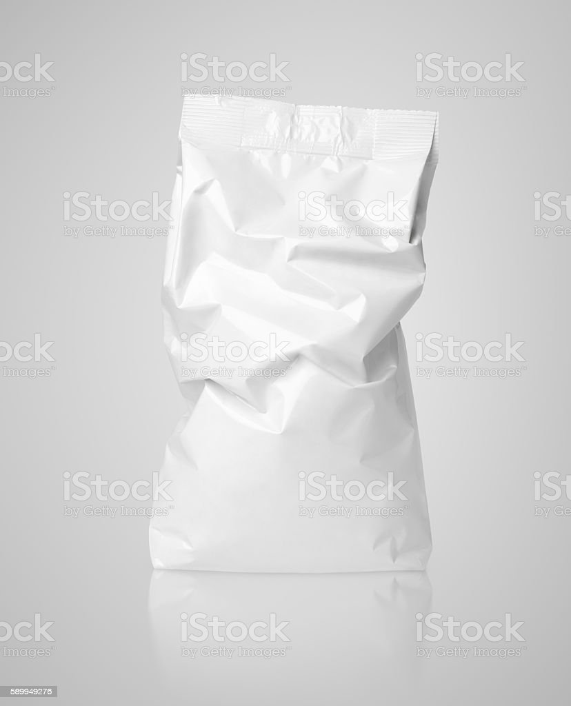 Crumpled blank paper bag package with creases on gray stock photo