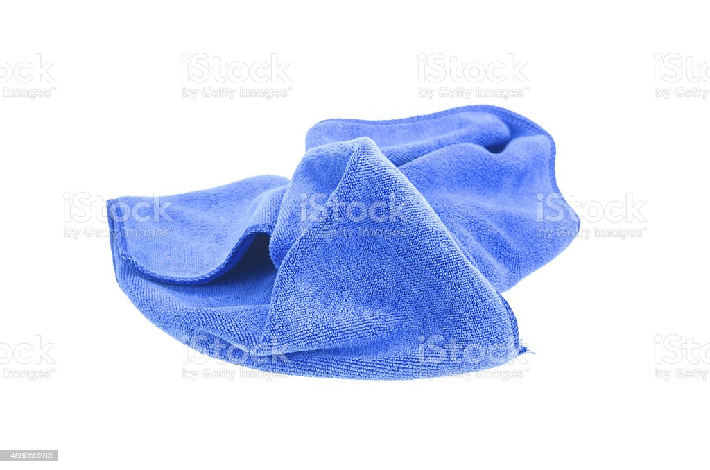 Crumpled blue microfiber cloth isolated on white background stock photo