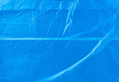 crumpled blue polyethylene texture, close up, full frame