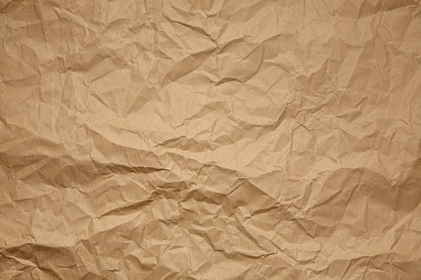 Crumpled brown paper pattern or background foto