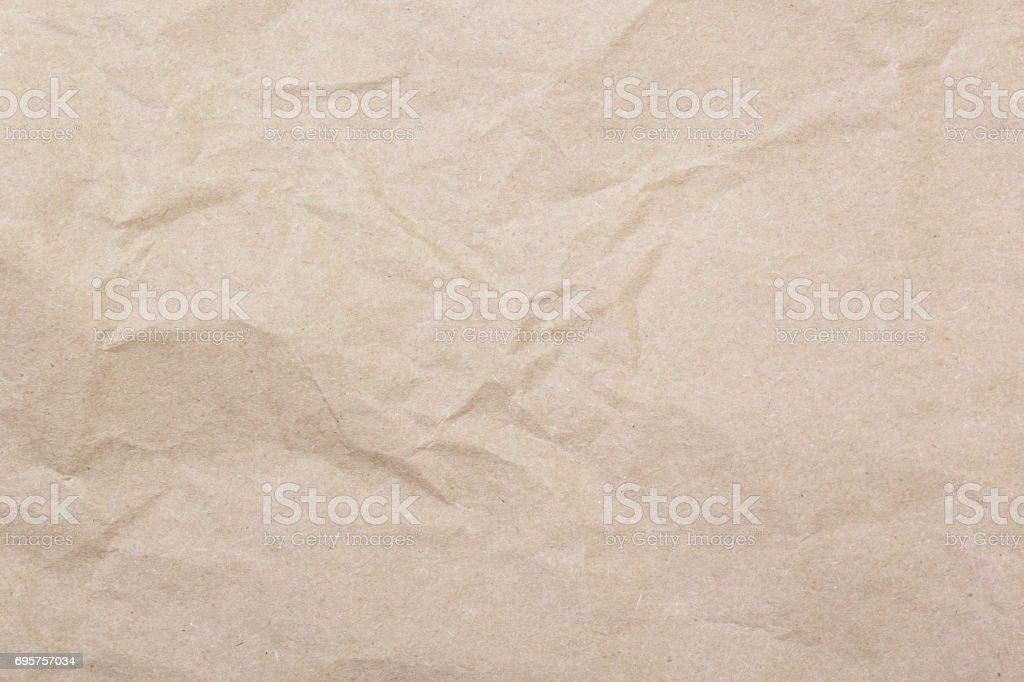 Crumpled brown paper texture stock photo