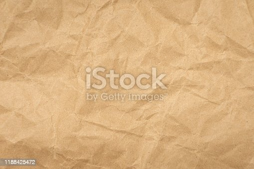 istock Crumpled brown paper texture vintage background. 1188425472