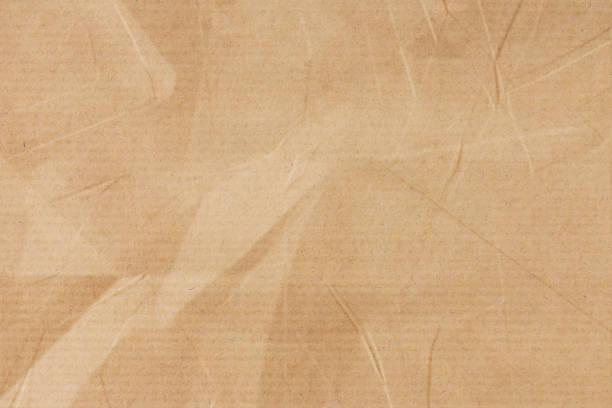 zmięty brązowy papier w paski - karton tworzywo zdjęcia i obrazy z banku zdjęć