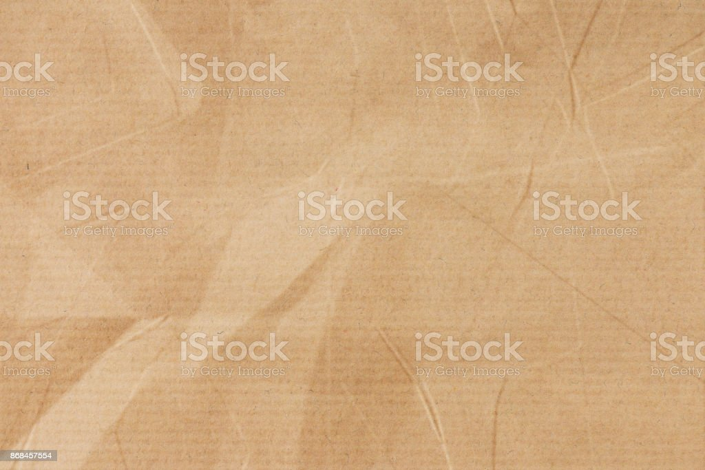 Crumpled brown striped paper stock photo