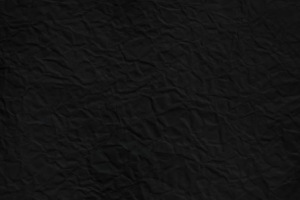 Crumpled dark paper texture 2 stock photo