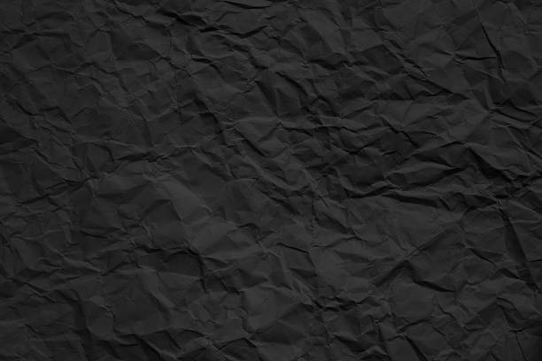 crumpled dark paper texture stock photo
