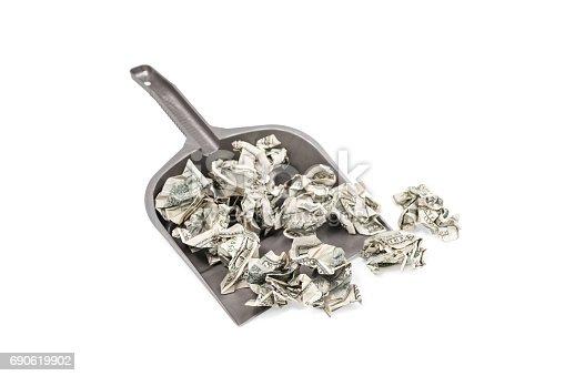 istock Crumpled dollars in a scoop 690619902