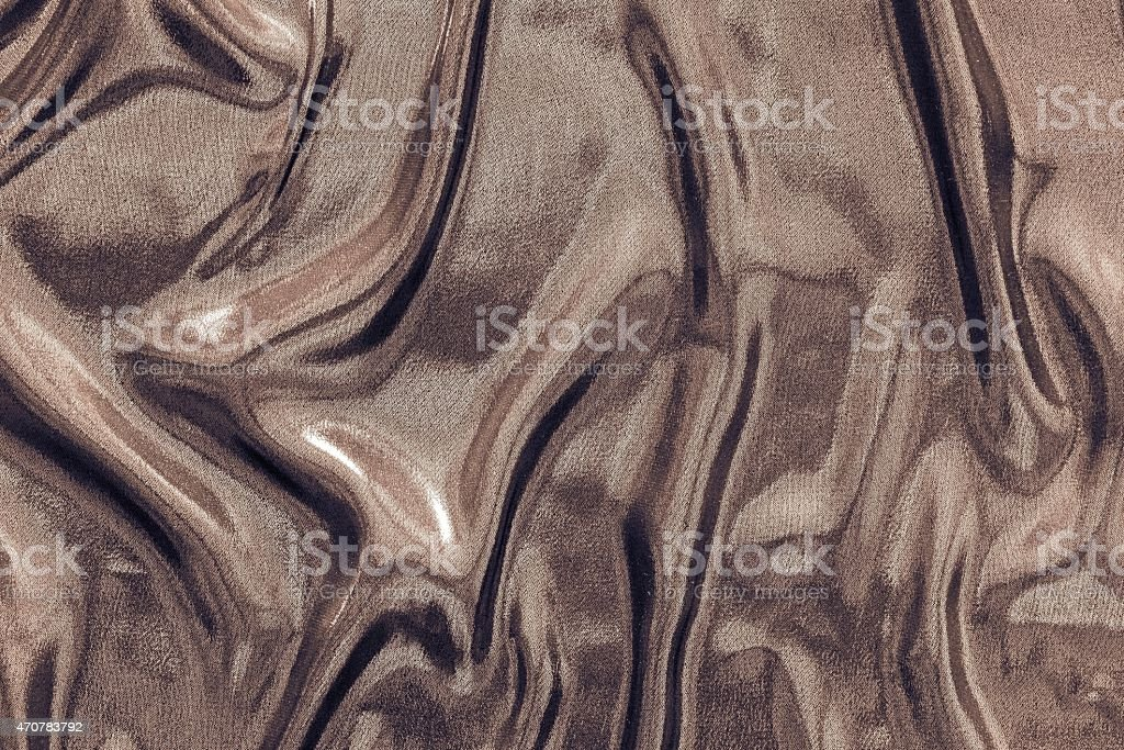 crumpled fabric of glossy chocolate color stock photo