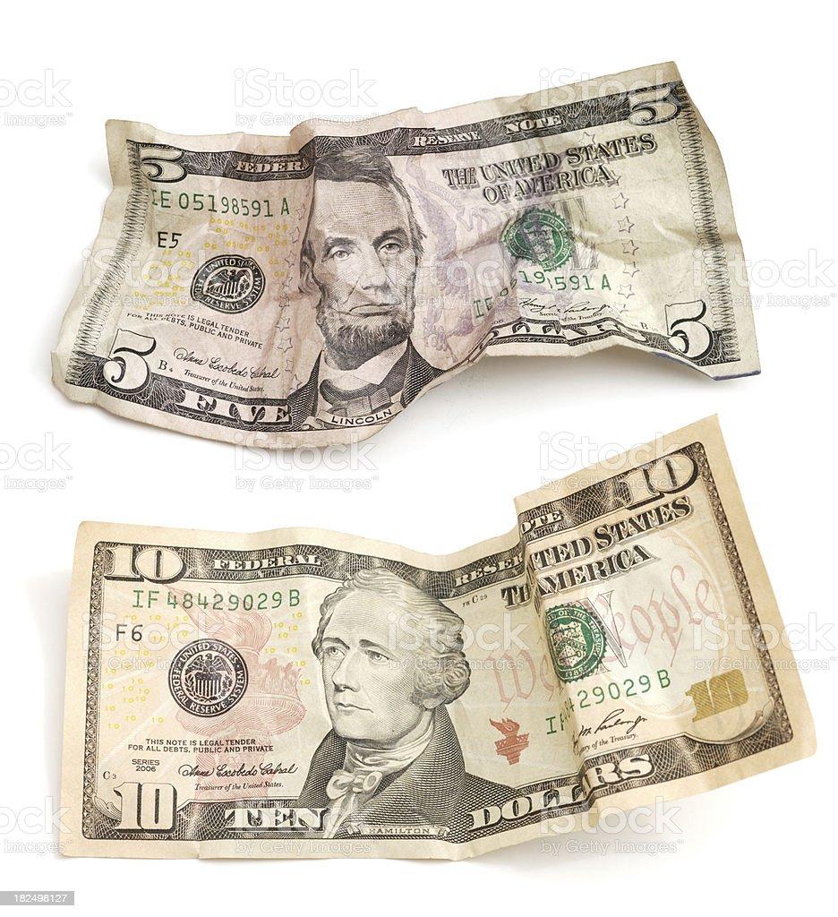 Crumpled Five and Ten dollar bills on white stock photo