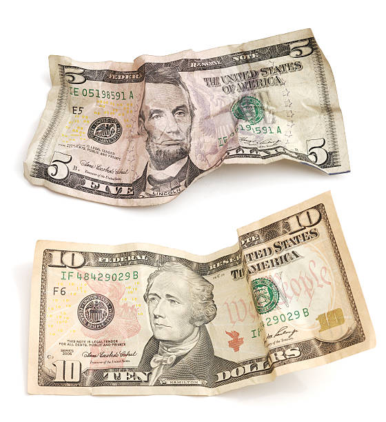 Crumpled Five and Ten dollar bills on white stock photo