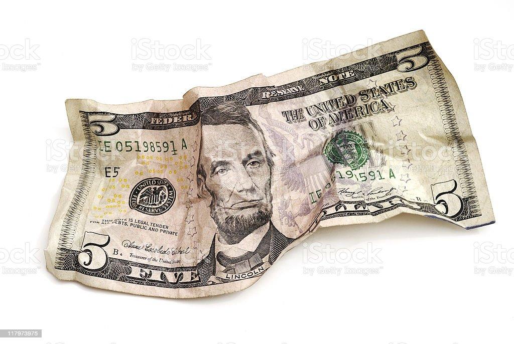 Crumpled five dollar bill royalty-free stock photo