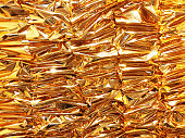 istock Crumpled gold foil paper texture background. 1078578882