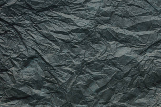 Crumpled gray paper background stock photo