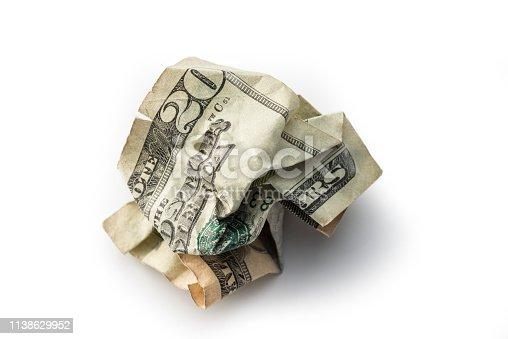 Crumpled twenty dollar bill on white background